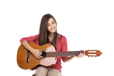 girl posing with classical guitar.